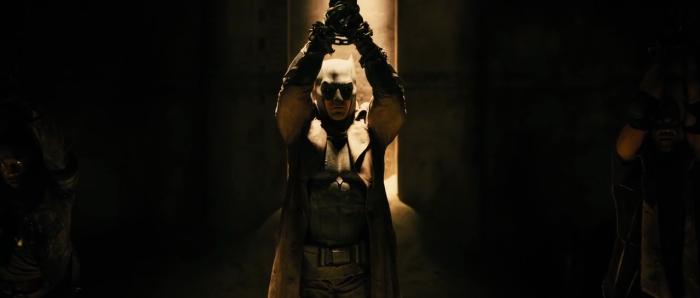 Figure 7 - Batman hangs by his wrists - Z Snyder